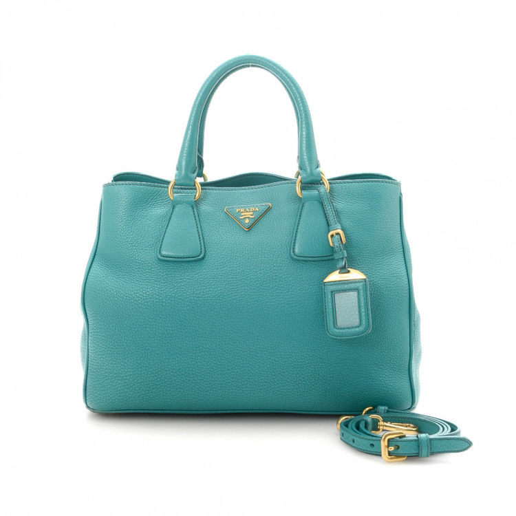 f9a2b263296c The authenticity of this vintage Prada Two Way handbag is guaranteed by  LXRandCo. This classic bag was crafted in vitello daino leather in  beautiful ...