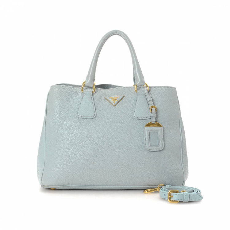 bbb671110f5c LXRandCo guarantees the authenticity of this vintage Prada Two Way tote.  This everyday tote bag in light blue is made in vitello daino leather.