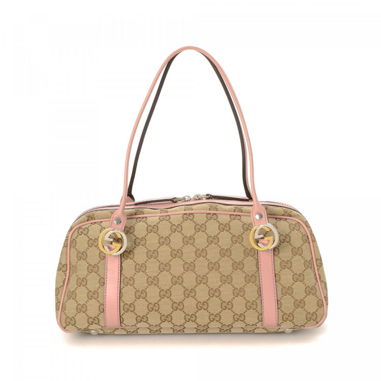 e4effb1a939 LXRandCo guarantees this is an authentic vintage Gucci Twins tote. Crafted  in gg canvas