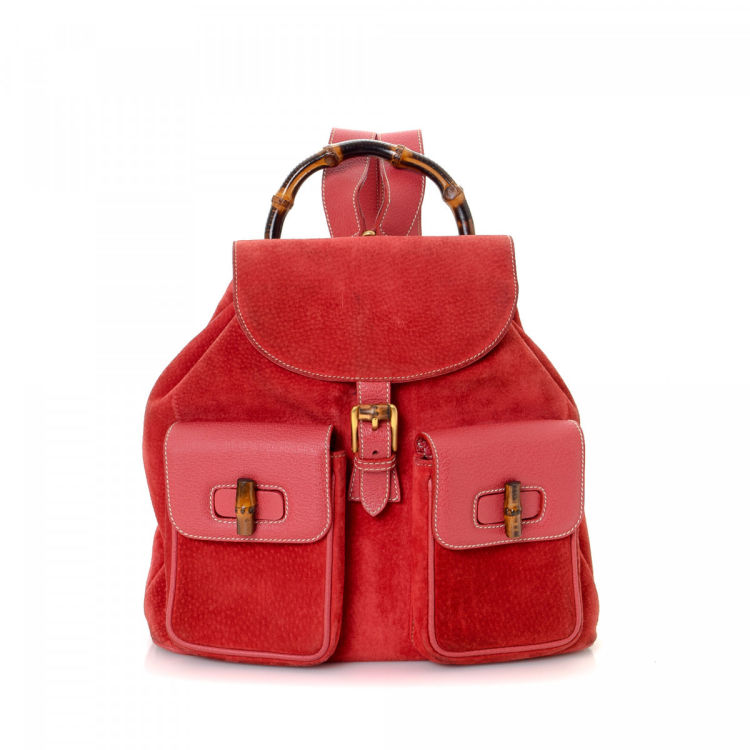 b740fe588df0 The authenticity of this vintage Gucci Bamboo Suede backpack is guaranteed  by LXRandCo. This everyday backpack in beautiful brick red is made of leather  and ...