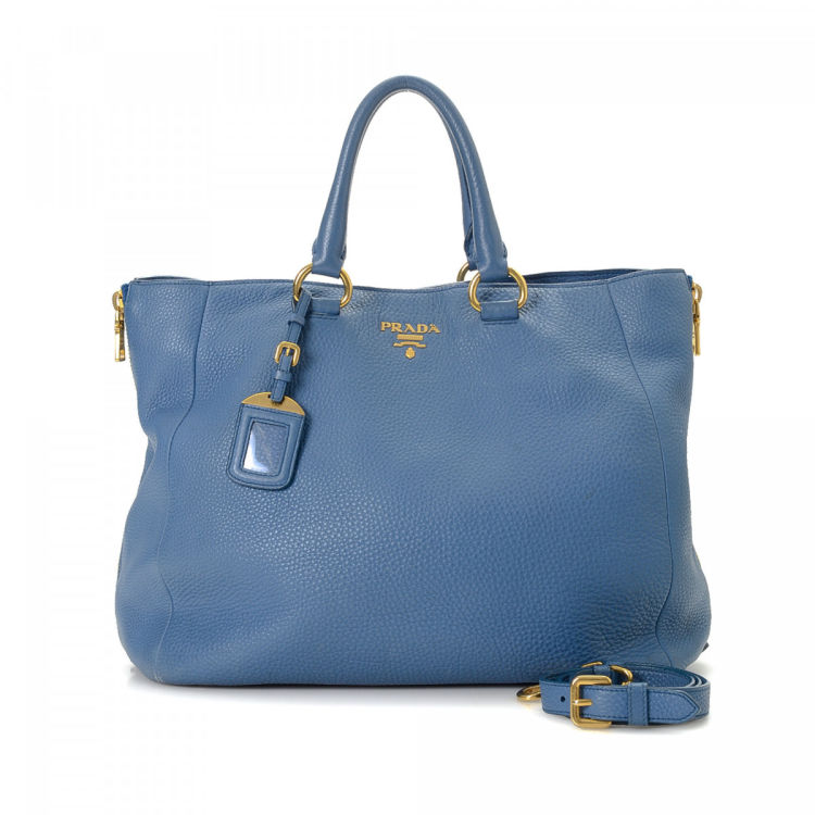ac2a51a99240 LXRandCo guarantees this is an authentic vintage Prada Two Way tote. This  luxurious tote bag in beautiful light blue is made in vitello daino leather.