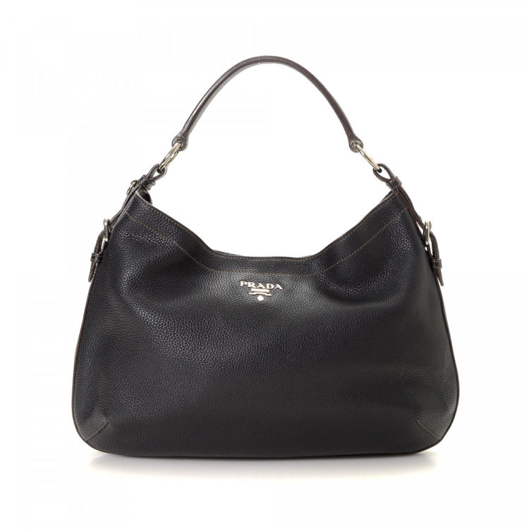 15182c66da77 LXRandCo guarantees this is an authentic vintage Prada Hobo Bag shoulder bag.  This chic purse was crafted in vitello daino leather in beautiful black.
