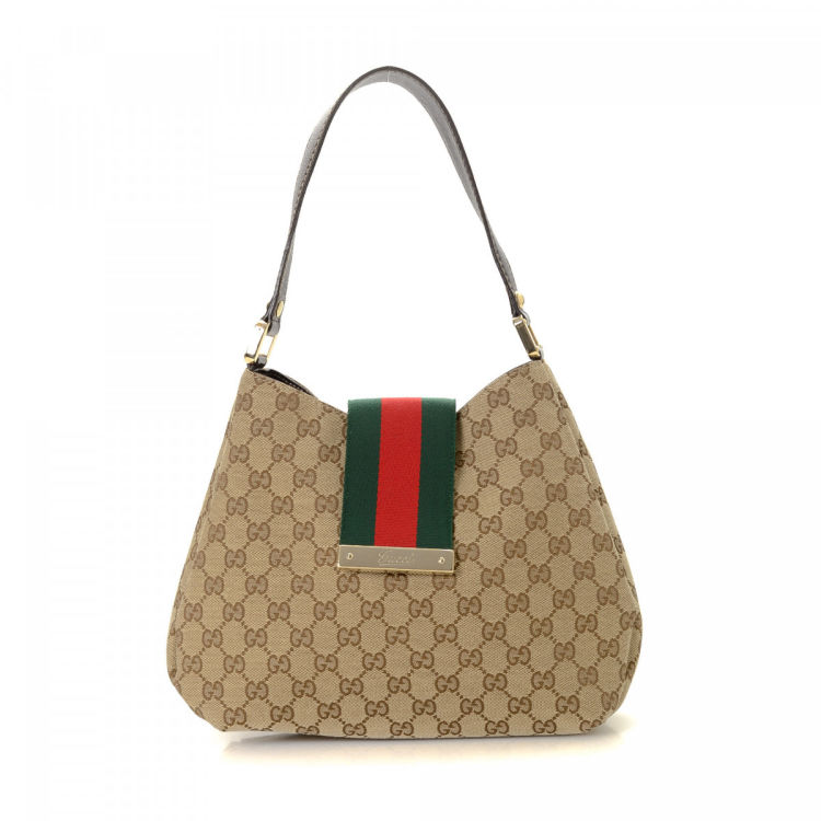 8111e53dcd6 LXRandCo guarantees the authenticity of this vintage Gucci Web Hobo Bag  shoulder bag. This classic purse in beautiful beige is made in gg canvas.