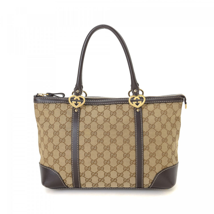 c7d766124d5 LXRandCo guarantees the authenticity of this vintage Gucci Lovely tote.  Crafted in gg canvas