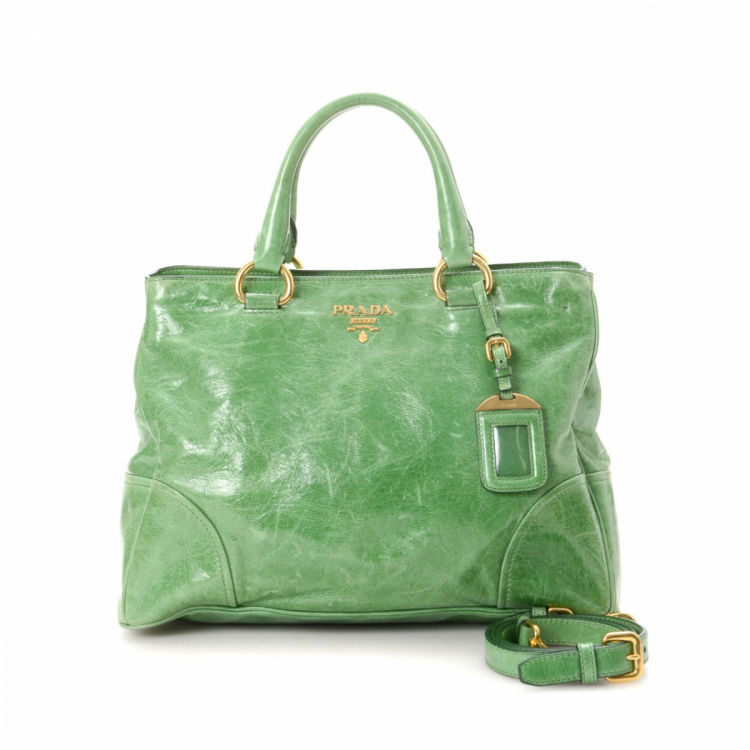 b7c9431397f2 LXRandCo guarantees the authenticity of this vintage Prada Two Way handbag.  This beautiful purse in light green is made in vitello shine leather.