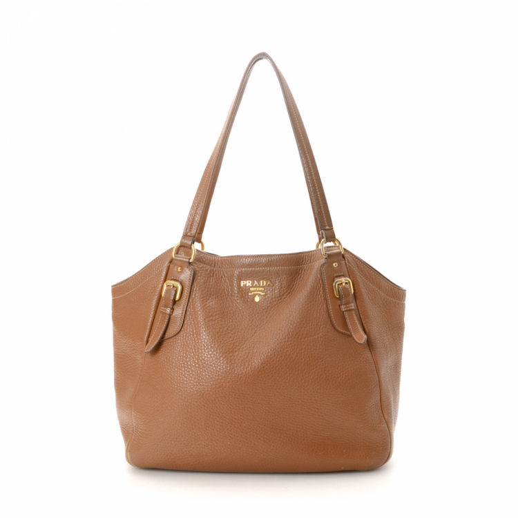 b5c7cbd809ff LXRandCo guarantees this is an authentic vintage Prada tote. Crafted in vitello  daino leather