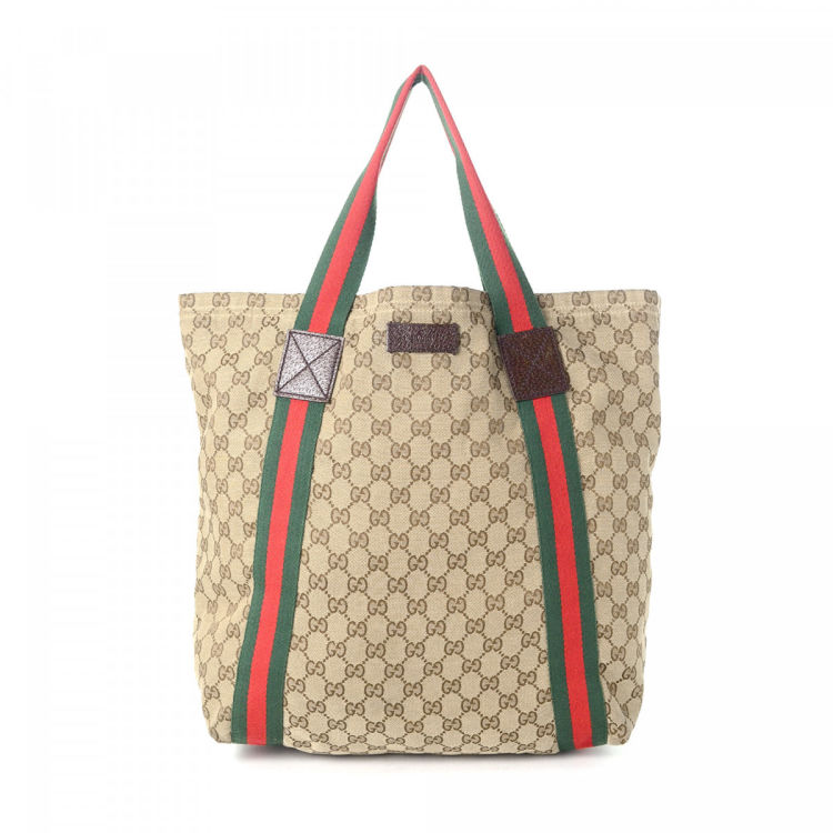 b33484d5678 The authenticity of this vintage Gucci Web tote is guaranteed by LXRandCo.  Crafted in gg canvas