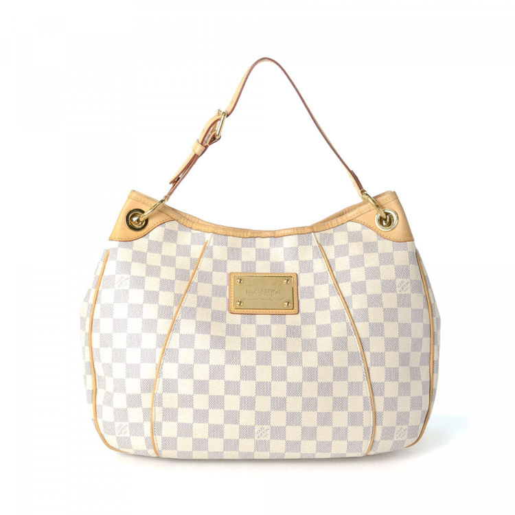 8102a468a778 LXRandCo guarantees the authenticity of this vintage Louis Vuitton Galliera  PM shoulder bag. This everyday purse in white is made in damier azur coated  ...