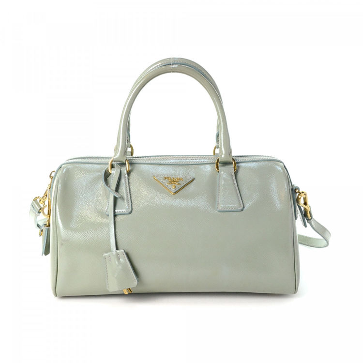1e4ebc95f6a7 LXRandCo guarantees this is an authentic vintage Prada Two Way handbag.  Crafted in saffiano patent leather, this sophisticated purse comes in light  green.
