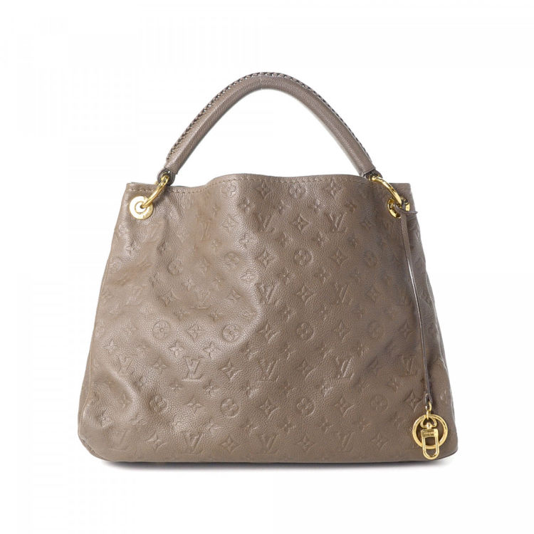 7b131bf20b37 LXRandCo guarantees the authenticity of this vintage Louis Vuitton Artsy MM  shoulder bag. This luxurious purse was crafted in monogram empreinte  leather in ...