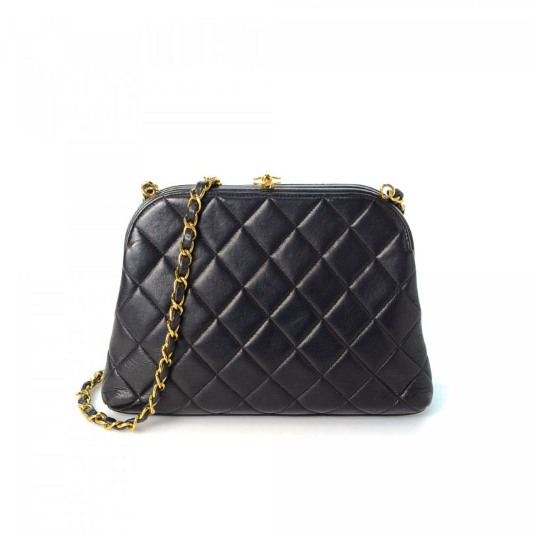 b147a825c6bdda LXRandCo guarantees this is an authentic vintage Chanel Chain shoulder bag.  Crafted in lambskin, this exquisite shoulder bag comes in black.