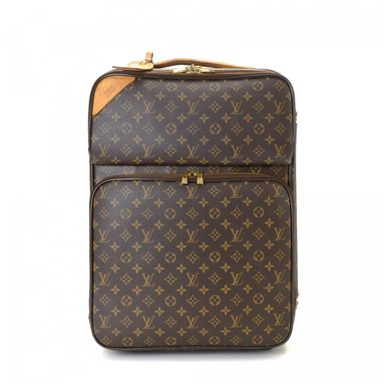 75585a127d LXRandCo guarantees this is an authentic vintage Louis Vuitton Pegase 55  Business travel bag. Crafted in monogram coated canvas