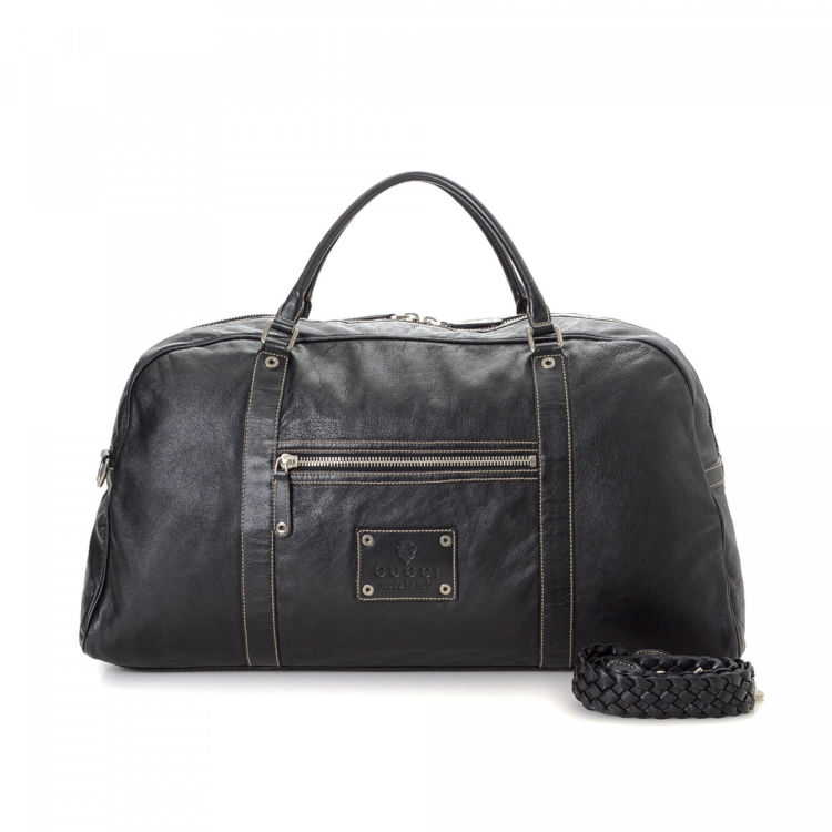 122ea66cc4a0 LXRandCo guarantees this is an authentic vintage Gucci travel bag. This  classic carryall in black is made of leather. Due to the vintage nature of  this ...