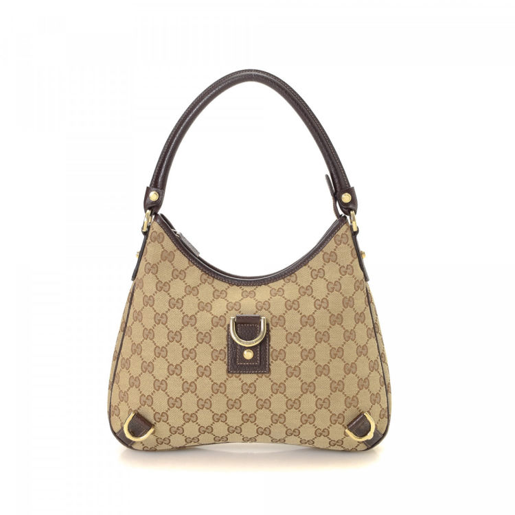 6eb186506271 LXRandCo guarantees this is an authentic vintage Gucci Abbey Hobo Bag  shoulder bag. This beautiful bag was crafted in gg canvas in beige.