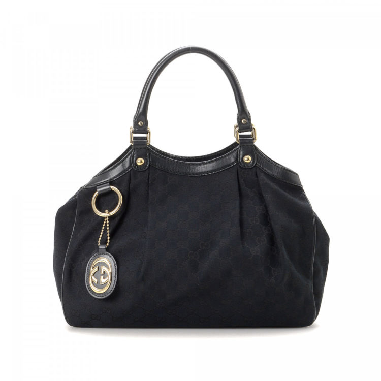 fc79d5ab021e LXRandCo guarantees the authenticity of this vintage Gucci Sukey tote.  Crafted in gg canvas, this elegant tote bag comes in black. Very good  condition* (A)