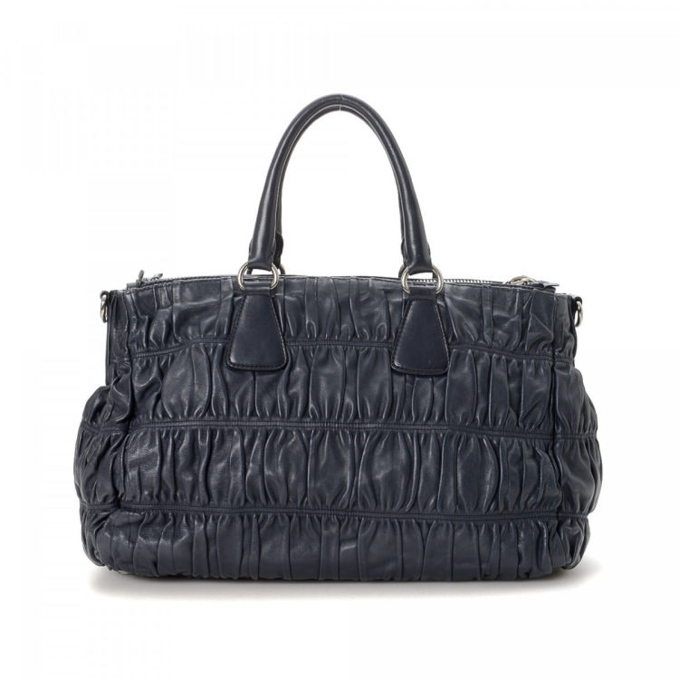 b1a6898ad297 The authenticity of this vintage Prada Nappa Gaufre Two Way Bag tote is  guaranteed by LXRandCo. Crafted in nappa gaufré leather, this lovely work  bag comes ...