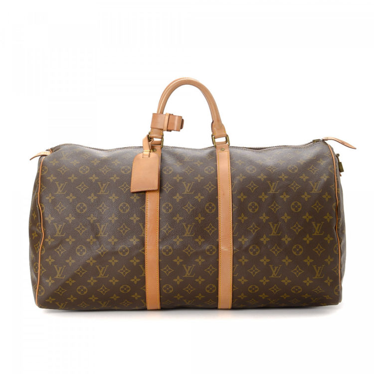 9a15a939c26f2 The authenticity of this vintage Louis Vuitton Keepall 55 travel bag is  guaranteed by LXRandCo. This refined boston bag in brown is made in monogram  coated ...