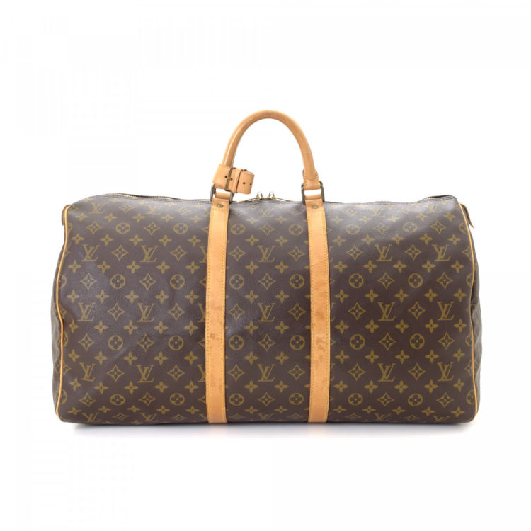 c01bda1a3 LXRandCo guarantees the authenticity of this vintage Louis Vuitton Keepall  55 travel bag. Crafted in monogram coated canvas, this elegant weekender  comes in ...