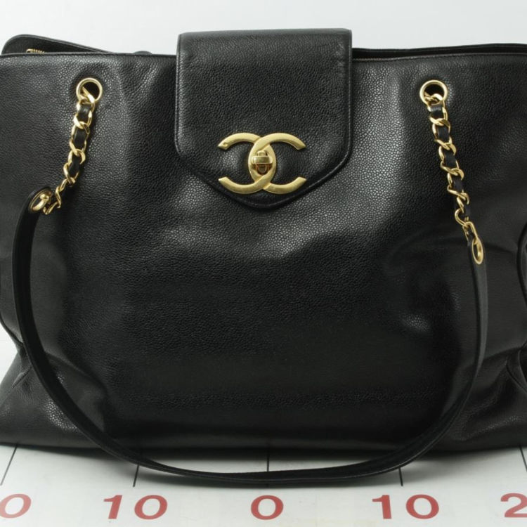 6498c384527764 LXRandCo guarantees this is an authentic vintage Chanel Supermodel shoulder  bag. This refined satchel was crafted in caviar leather in beautiful black.