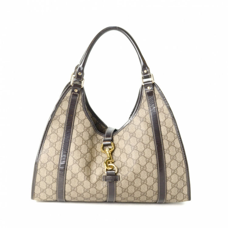 59321acdfe00 LXRandCo guarantees this is an authentic vintage Gucci shoulder bag. This  everyday purse in beautiful beige is made in gg supreme coated canvas.