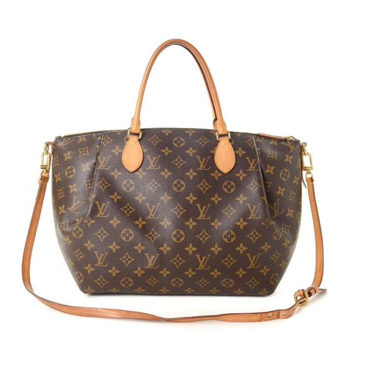 3c6909c85348 LXRandCo guarantees the authenticity of this vintage Louis Vuitton Turenne  GM handbag. Crafted in monogram coated canvas