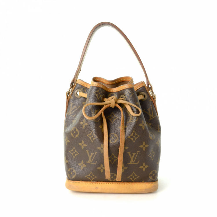 c1e44ba9bc50 LXRandCo guarantees the authenticity of this vintage Louis Vuitton Mini Noe  handbag. This luxurious handbag in beautiful brown is made in monogram  coated ...