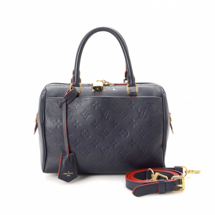 ccab3725b02b LXRandCo guarantees this is an authentic vintage Louis Vuitton Speedy 30  handbag. This beautiful purse in navy is made in monogram empreinte leather.