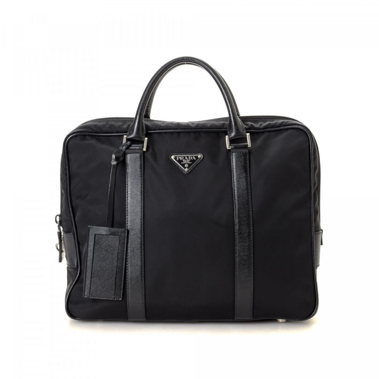 1abd4fe37fcf The authenticity of this vintage Prada Business Bag briefcase is guaranteed  by LXRandCo. This chic work bag in beautiful black is made in tessuto nylon.