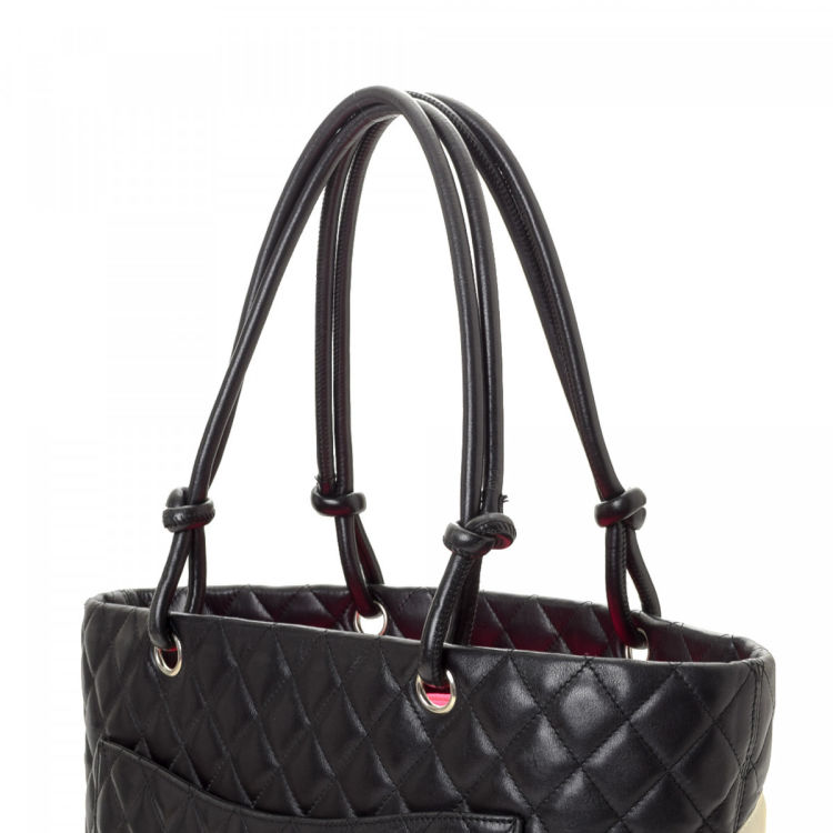 e1ec0e08f3c073 LXRandCo guarantees the authenticity of this vintage Chanel Cambon Ligne  tote. This chic bag comes in black leather. Due to the vintage nature of  this ...