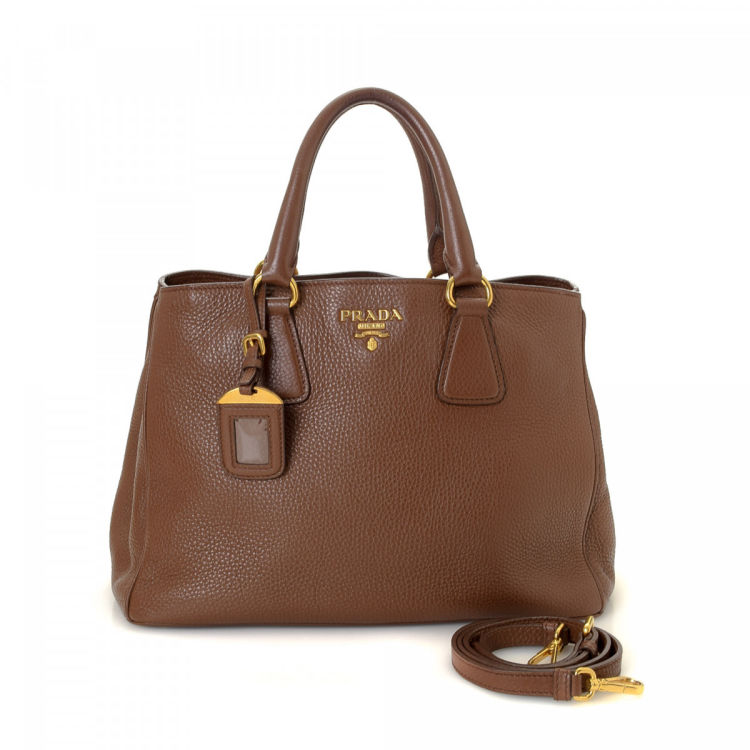 43331282fb2b LXRandCo guarantees the authenticity of this vintage Prada Two Way Bag  tote. This exquisite work bag was crafted in vitello daino leather in brown.