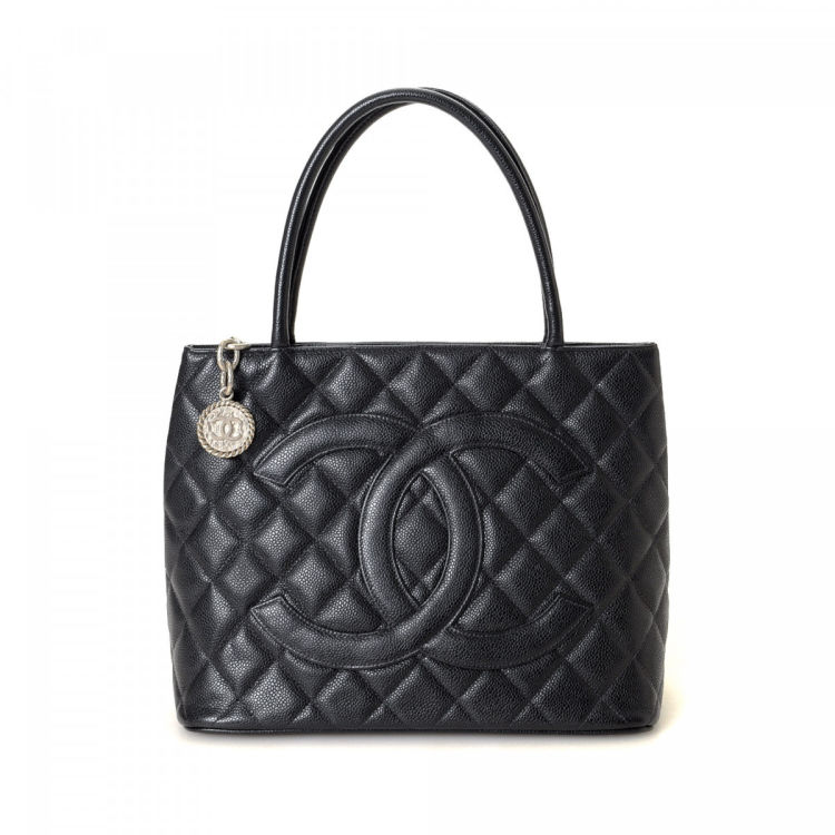 605a9f44534817 LXRandCo guarantees the authenticity of this vintage Chanel Medallion tote.  Crafted in caviar calf, this chic bag comes in black. Due to the vintage  nature ...