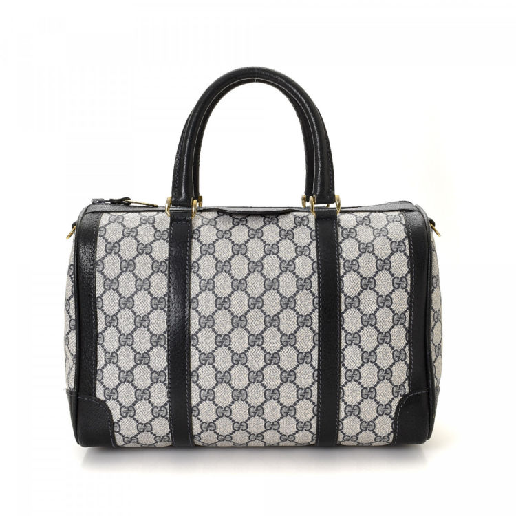 4325c63f236d LXRandCo guarantees the authenticity of this vintage Gucci Boston Bag  handbag. This elegant bag in navy is made in gg supreme coated canvas.