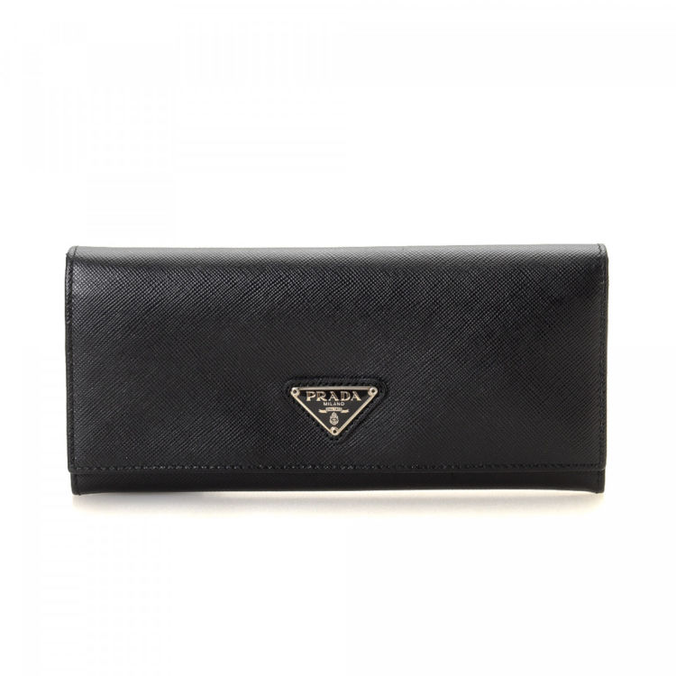 6472c543c9e6 The authenticity of this vintage Prada Long wallet is guaranteed by LXRandCo.  Crafted in saffiano leather, this luxurious wallet comes in beautiful black.