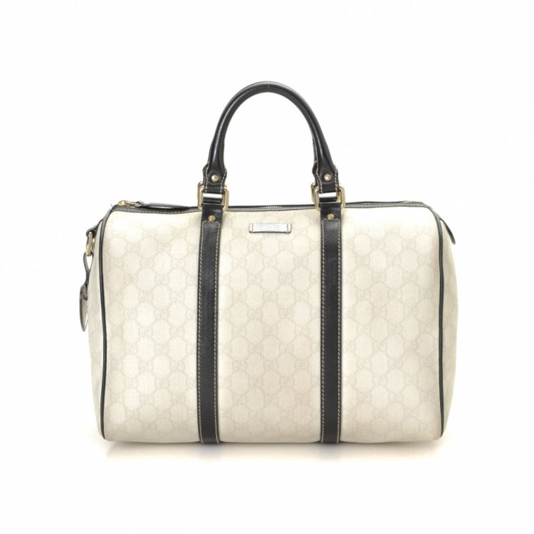 e21d385aef6529 The authenticity of this vintage Gucci Joy Boston Bag handbag is guaranteed  by LXRandCo. This sophisticated handbag in ivory is made in gg supreme  coated ...
