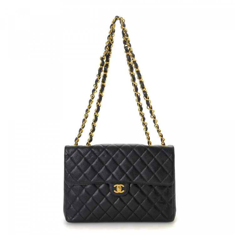 ae435d6516f9 LXRandCo guarantees this is an authentic vintage Chanel Maxi Flap shoulder  bag. This sophisticated satchel was crafted in caviar calf in beautiful  black.