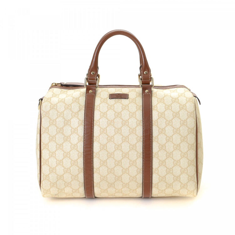83de66c7076 LXRandCo guarantees this is an authentic vintage Gucci Boston Bag handbag.  This signature purse in beautiful ivory is made in gg supreme coated canvas.