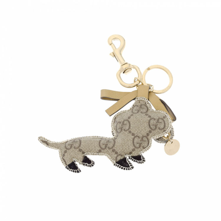 4111735b734 LXRandCo guarantees this is an authentic vintage Gucci Key Ring Dog Charm  jewelry. Crafted in gg supreme coated canvas