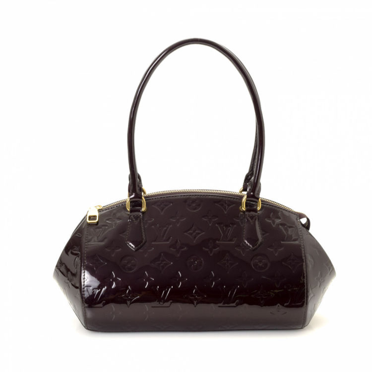 6bebf457bbae LXRandCo guarantees this is an authentic vintage Louis Vuitton Sherwood PM  shoulder bag. Crafted in monogram vernis patent leather