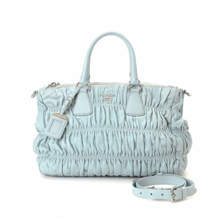 07b4d50a6f5d The authenticity of this vintage Prada Nappa Gaufre Two Way Bag tote is  guaranteed by LXRandCo. Crafted in nappa gaufré leather, this exquisite bag  comes in ...