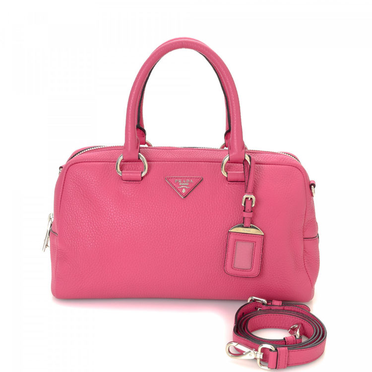 cfe6fcee1cd1 LXRandCo guarantees this is an authentic vintage Prada Two Way handbag.  Crafted in vitello daino leather, this lovely bag comes in beautiful pink.