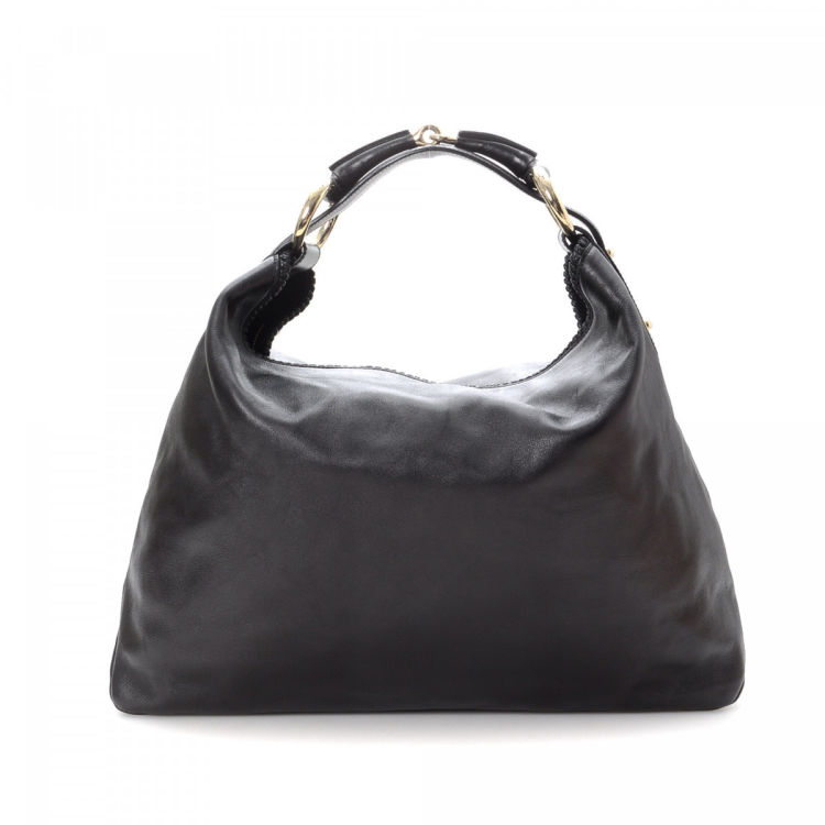 ae1aa26eb09 LXRandCo guarantees the authenticity of this vintage Gucci Horsebit Hobo  Bag shoulder bag. This elegant bag was crafted in leather in beautiful  black.