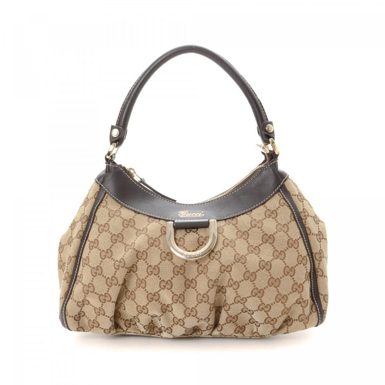 3b31502f601 The authenticity of this vintage Gucci D-Gold Hobo Bag shoulder bag is  guaranteed by LXRandCo. This chic satchel in beautiful beige is made in gg  canvas.
