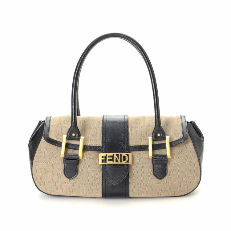 f5f2b7a45c00 The authenticity of this vintage Fendi handbag is guaranteed by LXRandCo.  This refined purse in beautiful beige is made in zucca canvas.