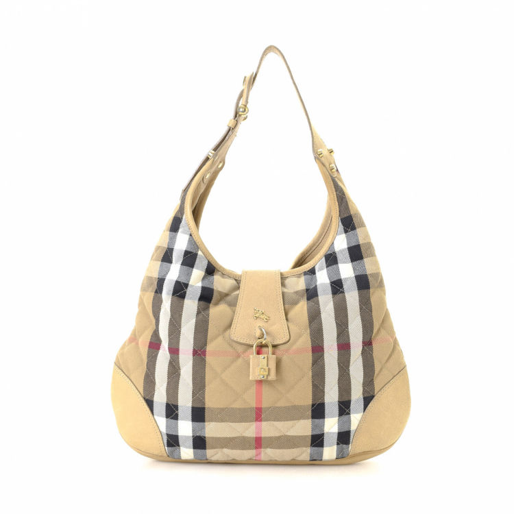 b16d0a7dcaa0 LXRandCo guarantees this is an authentic vintage Burberry Hobo shoulder bag.  Crafted in haymarket check canvas