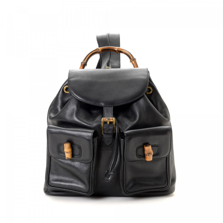e2379b4db9d LXRandCo guarantees the authenticity of this vintage Gucci Bamboo backpack.  This everyday backpack in black is made of leather. Due to the vintage  nature of ...