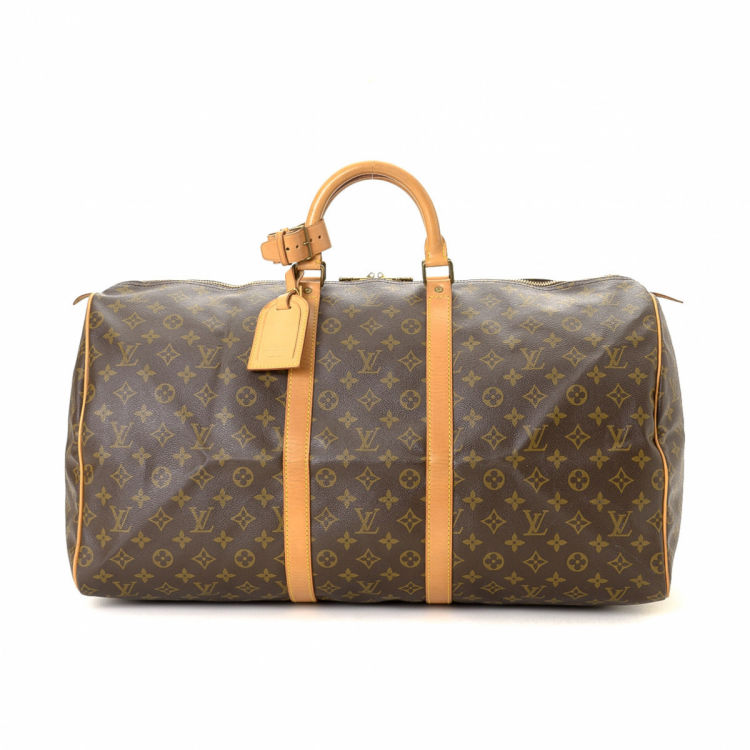 88993281b4b6 LXRandCo guarantees the authenticity of this vintage Louis Vuitton Keepall  55 travel bag. Crafted in monogram coated canvas
