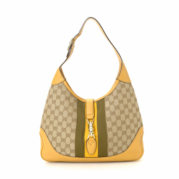73d04dc5c8c LXRandCo guarantees the authenticity of this vintage Gucci Jackie shoulder  bag. This beautiful satchel was crafted in gg canvas in beige.