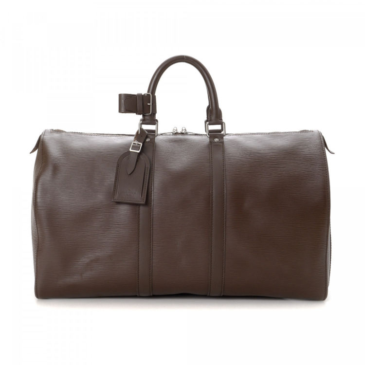 8ba505bfb2b1 LXRandCo guarantees this is an authentic vintage Louis Vuitton Keepall 45  travel bag. This lovely overnight bag in dark brown is made in epi leather.