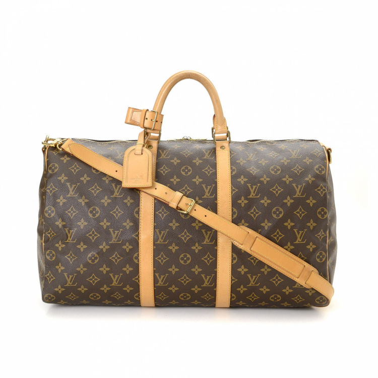 d90ea9c8e402 The authenticity of this vintage Louis Vuitton Keepall 50 Bandoulière  travel bag is guaranteed by LXRandCo. This refined weekender in brown is  made in ...