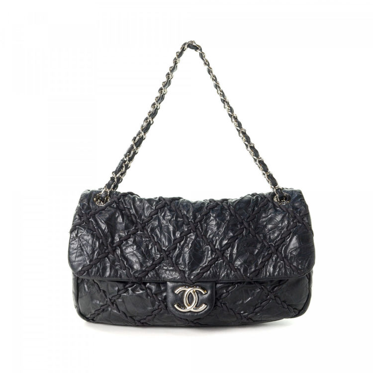 3ceaa52a0aa0d7 The authenticity of this vintage Chanel Ultra Stitch Jumbo Flap shoulder bag  is guaranteed by LXRandCo. This beautiful bag comes in black calf.